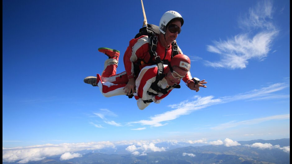 Accessible Travel Adventure Skydiving: Two men tandem skydive over New Zealand.