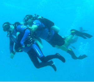 Scuba Diving: Man with autism is helped to scuba dive by an instructor.